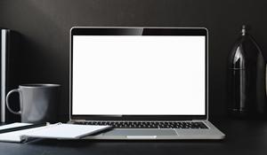 300macbook-pro-on-black-table-3787591